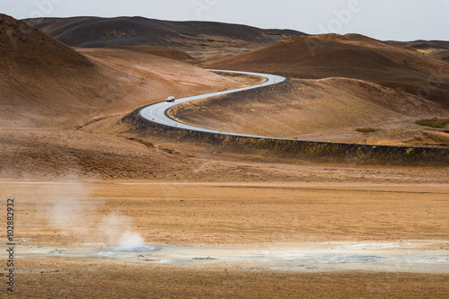 Foto op Aluminium Route 66 Geothermal mudpot Namafjall with curve road line and mountain range background in Autumn season Iceland