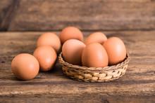 Chicken Eggs On Wooden Backgro...