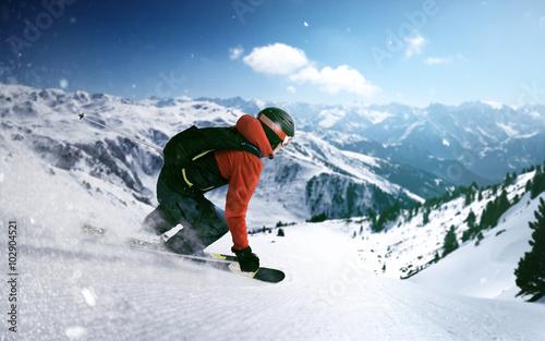 Fotobehang Wintersporten Skier goes downhill