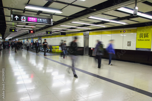 Poster Airport Crowd of passengers walk in Tsim Sha Tsui station on 7 Dec 2015. MTR is the main subway and train system in Hong Kong, and one of large transport networks in Asia