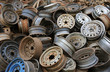 Heap of old car alloy wheels