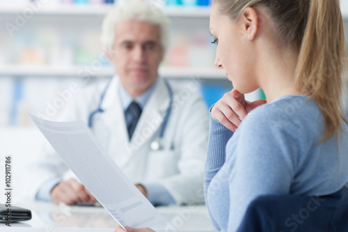Photo  Woman reading medical records