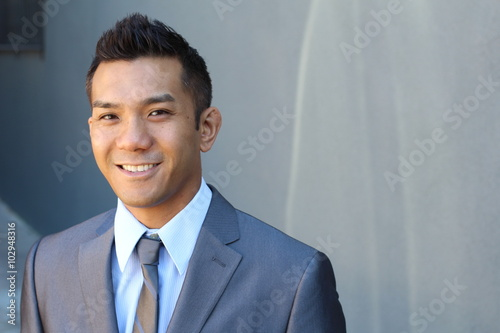 Foto  Portrait of a natural handsome classic Asian male with copy space on the right