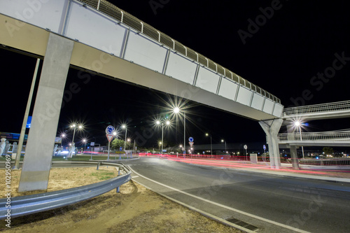 Fototapeta View of car streak lights at night near the airport of Faro city, Portugal. obraz na płótnie