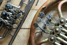 Old Horn And Trumpet On Wooden Background