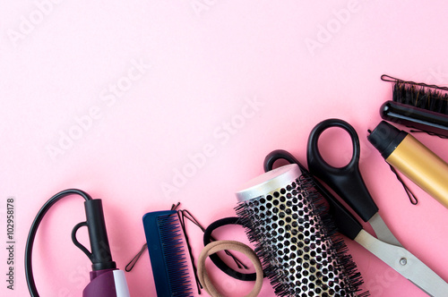 fototapeta na drzwi i meble Hairdressing tools on a pink background