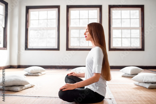 Woman practicing yoga indoors Plakát