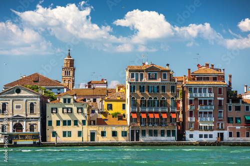 Spoed Foto op Canvas Gondolas A leaning bell tower in Venice, Italy