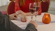 video 4K man and girl woman evening in restaurant drinking romantic wine, Valentine's Day