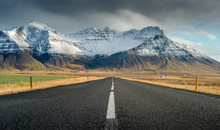 Perspective Road With Snow Mountain Range Background In Cloudy Day Autumn Season Iceland
