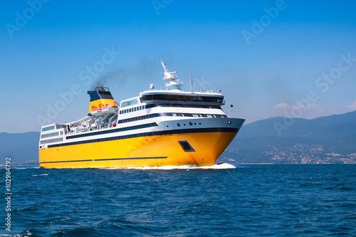 Fototapeta Big yellow passenger ferry on the Mediterranean Sea