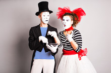 Two Mimes Use Of Tablet,  April Fools Day Concept