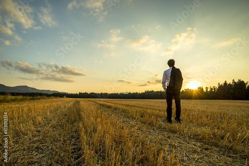 Fotografie, Obraz  Businessman in elegant suit with his jacket hanging over his sho