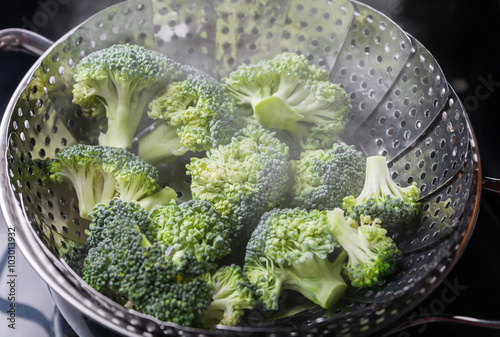 Freshly steamed green broccoli in skimmer pot Wallpaper Mural