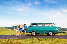 Young Frieds With Campervan, Green Nature And Blue Sky