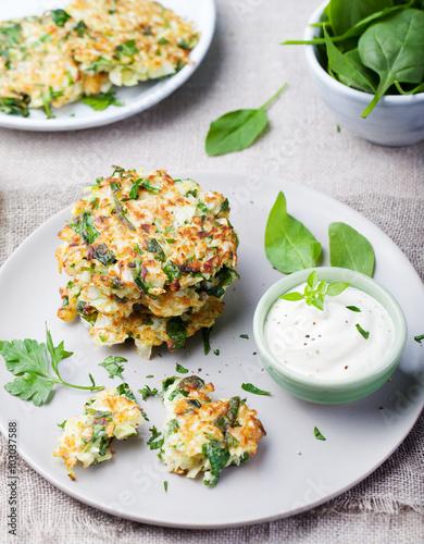 Deurstickers Klaar gerecht Cabbage and spinach pancakes with yogurt dressing with fresh herbs