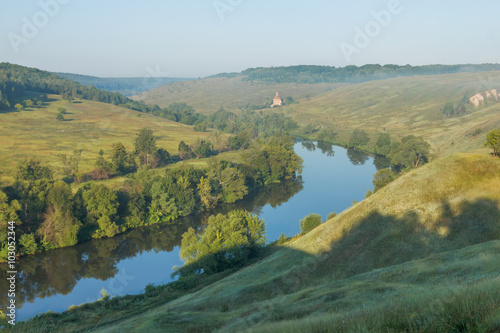 Deurstickers Asia land Summer landscape on the hilly banks of the river on a sunny morning