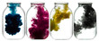 CMYK paint swirling in water. Splashes of paint in a glass jar.