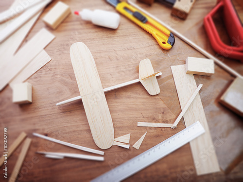 Handcrafting model airplane from wood Wallpaper Mural