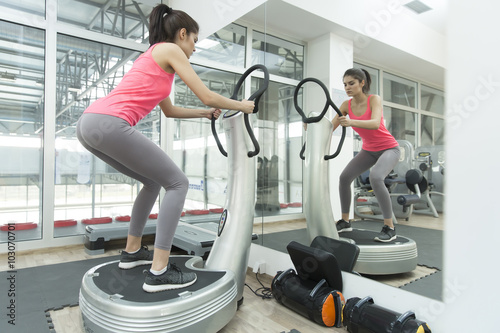 Fototapeta  Young woman training in the gym