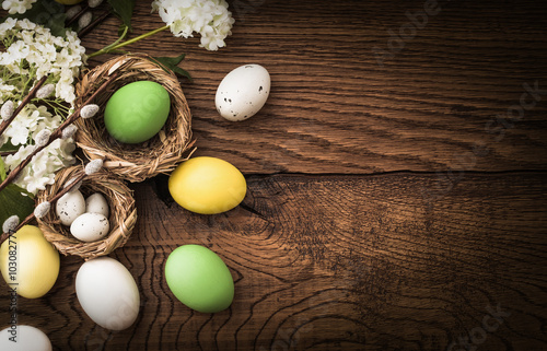 Photo  Easter eggs on wood background