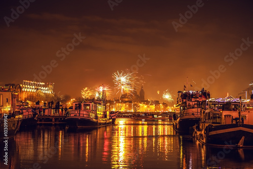 Photo  AMSTERDAM, NETHERLANDS - JANUARY 1, 2016: Festive salute of fireworks on New Year's night