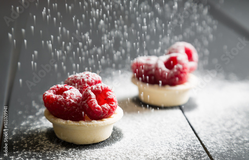 Poster Dessert delicious dessert tarts with fresh raspberries