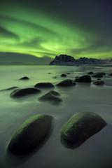 Fototapeta Zima Aurora borealis over a beach on the Lofoten in Norway