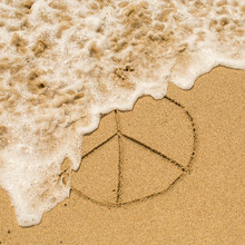 Peace Sign (pacific) Drawn On The Sand Of A Beach With The Soft Wave.
