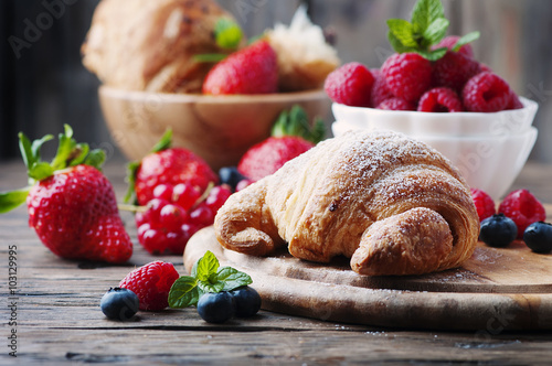 Fototapeta Fresh croissant with mix of berry