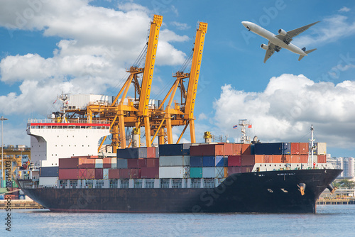 Wall Murals Port Industrial Container Cargo freight ship with working crane in sh