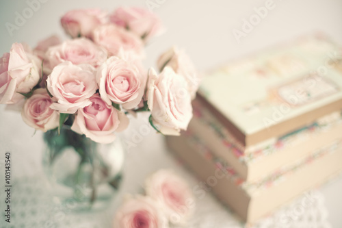 Fotografie, Obraz  Roses in a crystal vase and books with vintage dust jackets