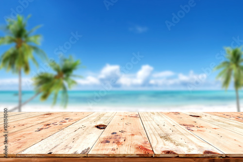 Top Of Wood Table With Blurred Sea And Blue Sky Background