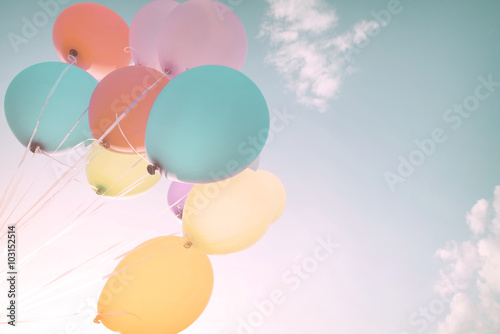 Colorful balloons in summer holidays. Pastel color filter Canvas Print