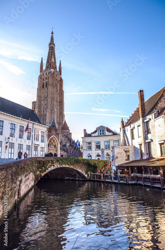 Wall Murals Bridges Medieval Church of Our Lady in Bruges in sunny evening, Belgium.