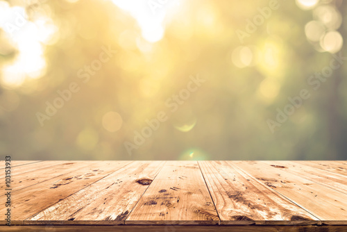 Fototapeta Top of wood table with blurred bokeh nature background - Empty ready for your product display or montage. obraz