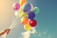 Girl Hand Holding Multicolor Balloons Done With A Retro Instagram Filter Effect, Concept Of Happy Birth Day In Summer And Wedding Honeymoon Party (Vintage Color Tone)
