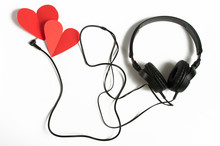Headphones And Red Hearts On A White Background