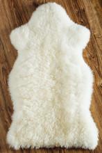 Sheepskin Carpet On Wooden Bac...