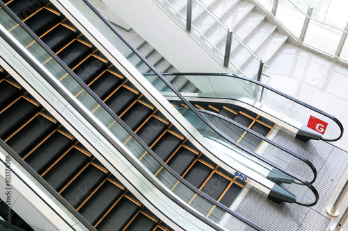 Photo Escalator stairs in station.