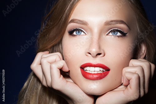 beautiful girl with red lips with hands near the face Canvas-taulu
