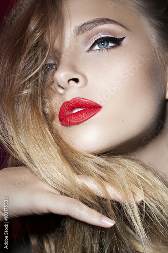 Valokuva  beautiful girl with red lips and hand near the face