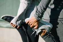 Women Stretching For Warming Up Before Running Or Working Out. Fitness And Healthy Lifestyle Concept.