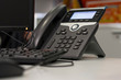 ip phone and computer on desk