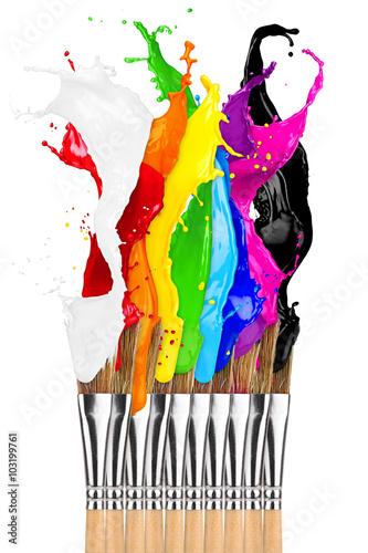 Photo  paintbrush row with colorful rainbow color splashes isolated on white background