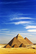 Egypt. Cairo - Giza. General view of pyramids from the Giza Plateau (there is 3 pyramids popularly known as Queens' Pyramids on front side; next: the Pyramid of Menkaure, Khafre and Chufu)