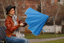 Lady Opening Blue Umbrella