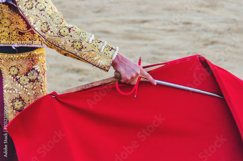 La pose en embrasure Corrida bullfighter cape and sword