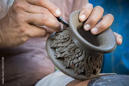 close up potter artist working on clay pottery sculpture fine ar Fototapeta