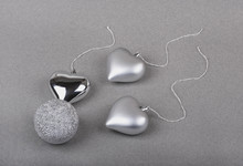 Metaphorical View Of Fertilization Presented With Christmas Toys, Silver Ball And Hearts Simulating Egg And Sperm.